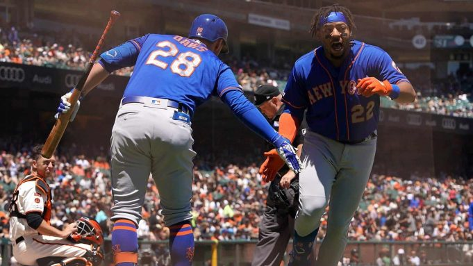 SAN FRANCISCO, CA - JULY 20: Dominic Smith #22 of the New York Mets is congratulated by J.D. Davis #28 after Smith hit a solo home run against the San Francisco Giants in the top of the second inning at Oracle Park on July 20, 2019 in San Francisco, California.