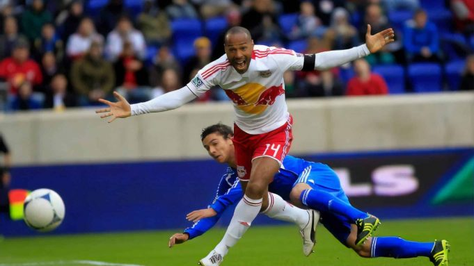 HARRISON, NJ - MARCH 31: Thierry Henry #14 of the New York Red Bulls is challenged by Zarek Valentin #19 of the Montreal Impact at Red Bull Arena on March 31, 2012 in Harrison, New Jersey.