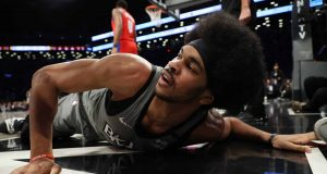 NEW YORK, NEW YORK - JANUARY 29: Jarrett Allen #31 of the Brooklyn Nets falls against the Detroit Pistons during their game at Barclays Center on January 29, 2020 in New York City.