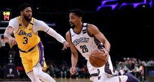 LOS ANGELES, CALIFORNIA - MARCH 10: Spencer Dinwiddie #26 of the Brooklyn Nets drives to the basket on Anthony Davis #3 of the Los Angeles Lakers during the first half at Staples Center on March 10, 2020 in Los Angeles, California.