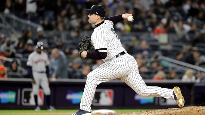 NEW YORK, NEW YORK - OCTOBER 17: Adam Ottavino #0 of the New York Yankees delivers the pitch against the Houston Astros during the eighth inning in game four of the American League Championship Series at Yankee Stadium on October 17, 2019 in New York City.