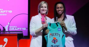 Louisville's Asia Durr, right, poses for photo with WNBA COO Christi Hedgpeth after being selected by the New York Liberty as the second overall pick in the WNBA basketball draft, Wednesday, April 10, 2019.