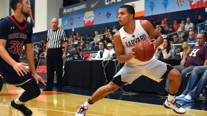 FULLERTON, CA - NOVEMBER 23: Jordan Ford #30 of the St. Mary's Gaels guards Bryce Aiken #11 of the Harvard Crimson as he looks to take a shot in the second half of the game at the Titan Gym on November 23, 2017 in Fullerton, California.