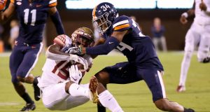 CHARLOTTESVILLE, VA - SEPTEMBER 14: Bryce Hall #34 of the Virginia Cavaliers breaks up a pass intended for Tamorrion Terry #15 of the Florida State Seminoles in the first half during a game at Scott Stadium on September 14, 2019 in Charlottesville, Virginia.