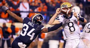 CHARLOTTESVILLE, VA - NOVEMBER 02: Bryce Hall #34 of the Virginia Cavaliers disrupts a pass by Kenny Pickett #8 of the Pittsburgh Panthers in the second half during a game at Scott Stadium on November 2, 2018 in Charlottesville, Virginia.