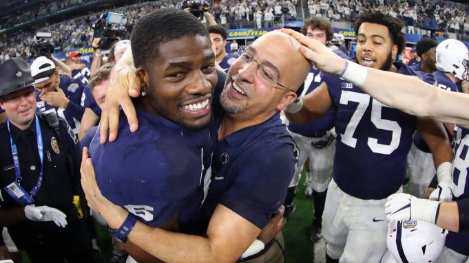 ARLINGTON, TEXAS - DECEMBER 28: Head coach James Franklin of the Penn State Nittany Lions celebrates with Cam Brown #6 of the Penn State Nittany Lions after the Nittany Lions beat the Memphis Tigers 53-39 at AT&T Stadium on December 28, 2019 in Arlington, Texas.