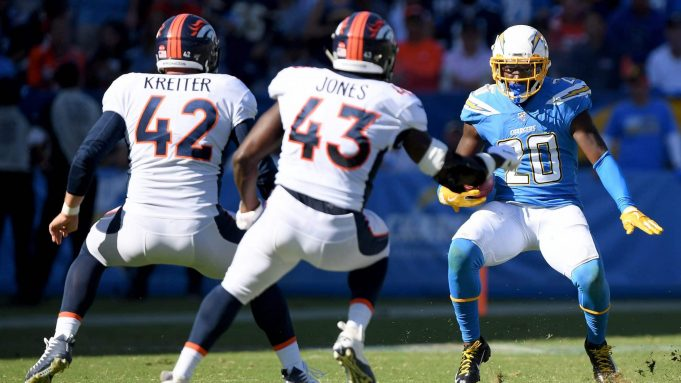 CARSON, CALIFORNIA - OCTOBER 06: Desmond King #20 of the Los Angeles Chargers deeks Casey Kreiter #42 and Joe Jones #43 of the Denver Broncos to score a touchdown from a punt return, to trail 17-7, during the third quarter in a 20-13 Broncos win at Dignity Health Sports Park on October 06, 2019 in Carson, California.