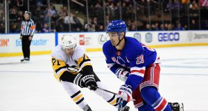 NEW YORK, NEW YORK - NOVEMBER 12: Chris Kreider #20 of the New York Rangers controls the puck with pressure from Evgeni Malkin #71 of the Pittsburgh Penguins during their game at Madison Square Garden on November 12, 2019 in New York City.
