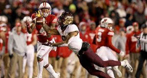 MADISON, WISCONSIN - NOVEMBER 24: Chris Williamson #6 of the Minnesota Golden Gophers intercepts a pass intended for A.J. Taylor #4 of the Wisconsin Badgers in the fourth quarter at Camp Randall Stadium on November 24, 2018 in Madison, Wisconsin.