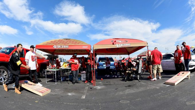 SANTA CLARA, CA - SEPTEMBER 22: San Francisco 49ers fans tailgating and playing the game Cornhole in the parking lot prior to the start of an NFL football game against the Pittsburgh Steelers at Levi's Stadium on September 22, 2019 in Santa Clara, California.