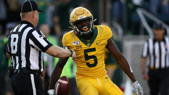 WACO, TEXAS - NOVEMBER 23: Denzel Mims #5 of the Baylor Bears celebrates a touchdown pass reception against the Texas Longhorns in the second half at McLane Stadium on November 23, 2019 in Waco, Texas.