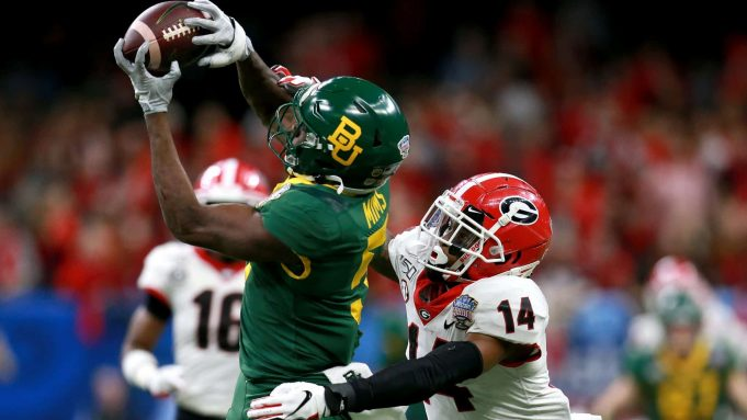 NEW ORLEANS, LOUISIANA - JANUARY 01: Denzel Mims #5 of the Baylor Bears catches a pass over DJ Daniel #14 of the Georgia Bulldogs during the Allstate Sugar Bowl at Mercedes Benz Superdome on January 01, 2020 in New Orleans, Louisiana.