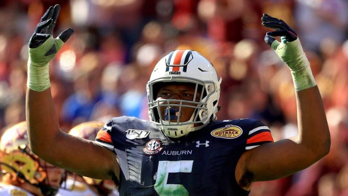 TAMPA, FLORIDA - JANUARY 01: Derrick Brown #5 of the Auburn Tigers reacts to a play during the 2020 Outback Bowl against the Minnesota Golden Gophers at Raymond James Stadium on January 01, 2020 in Tampa, Florida.
