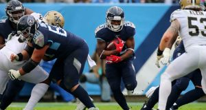 NASHVILLE, TENNESSEE - DECEMBER 22: Running back Dion Lewis #33 of the Tennessee Titans carries the ball in the second quarter against the New Orleans Saints at Nissan Stadium on December 22, 2019 in Nashville, Tennessee.