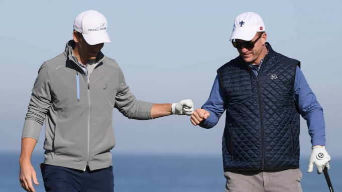 PEBBLE BEACH, CALIFORNIA - FEBRUARY 07: Former NFL players Eli and Peyton Manning celebrate during the second round of the AT&T Pebble Beach Pro-Am at Monterey Peninsula Country Club on February 07, 2020 in Pebble Beach, California.
