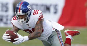 TAMPA, FLORIDA - SEPTEMBER 22: Tight end Evan Engram #88 of the New York Giants makes a catch and dives towards the sideline in the second quarter during the game against the Tampa Bay Buccaneers at Raymond James Stadium on September 22, 2019 in Tampa, Florida.