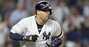 NEW YORK, NY - SEPTEMBER 3: Gary Sanchez #24 of the New York Yankees watches his solo home run against the Texas Rangers during the sixth inning at Yankee Stadium on September 3, 2019 in the Bronx borough of New York City.