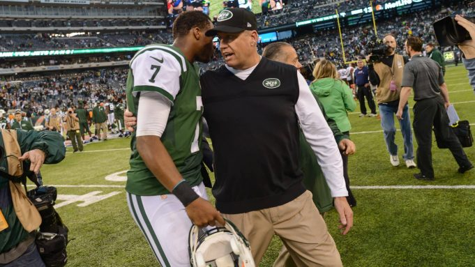 EAST RUTHERFORD, NJ - DECEMBER 22: Head coach Rex Ryan of the New York Jets and quarterback Geno Smith #7 of the New York Jets walk off together at the end of the game against the Cleveland Browns at MetLife Stadium on December 22, 2013 in East Rutherford, New Jersey.