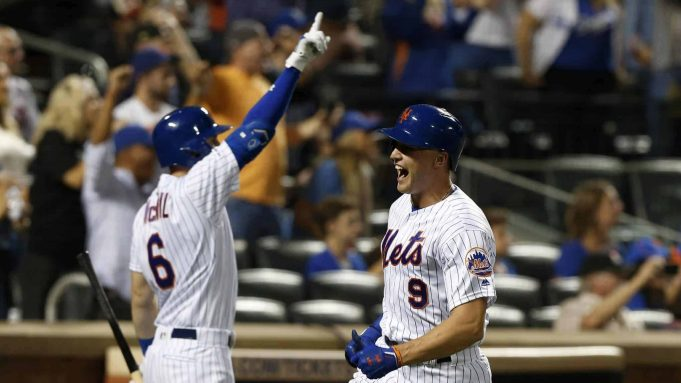 NEW YORK, NEW YORK - SEPTEMBER 14: Brandon Nimmo #9 of the New York Mets celebrates with teammate Jeff McNeil #6 after scoring a run in the eighth inning against the Los Angeles Dodgers at Citi Field on September 14, 2019 in New York City.