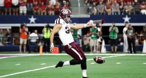ARLINGTON, TEXAS - SEPTEMBER 28: Braden Mann #34 of the Texas A&M Aggies punts to the Arkansas Razorbacks in the second quarter during the Southwest Classic at AT&T Stadium on September 28, 2019 in Arlington, Texas. New York Jets