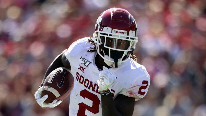 DALLAS, TEXAS - OCTOBER 12: CeeDee Lamb #2 of the Oklahoma Sooners runs the ball against the Texas Longhorns in the second quarter during the 2019 AT&T Red River Showdown at Cotton Bowl on October 12, 2019 in Dallas, Texas.