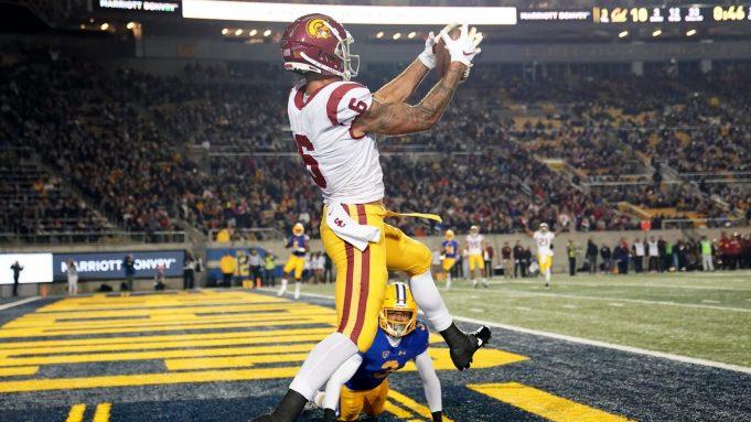 BERKELEY, CALIFORNIA - NOVEMBER 16: Michael Pittman Jr. #6 of the USC Trojans catches a touchdown pass over Elijah Hicks #3 of the California Golden Bears during the second quarter of an NCAA football game at California Memorial Stadium on November 16, 2019 in Berkeley, California.