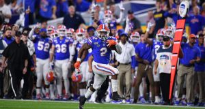 MIAMI, FLORIDA - DECEMBER 30: Lamical Perine #2 of the Florida Gators runs for a touchdown in the first half the Capital One Orange Bowl against the Virginia Cavaliers at Hard Rock Stadium on December 30, 2019 in Miami, Florida.
