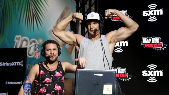 MIAMI, FLORIDA - JANUARY 31: (L-R) SiriusXM host Mike Babchik and former NFL player Rob Gronkowski speak onstage during day 3 of SiriusXM at Super Bowl LIV on January 31, 2020 in Miami, Florida.