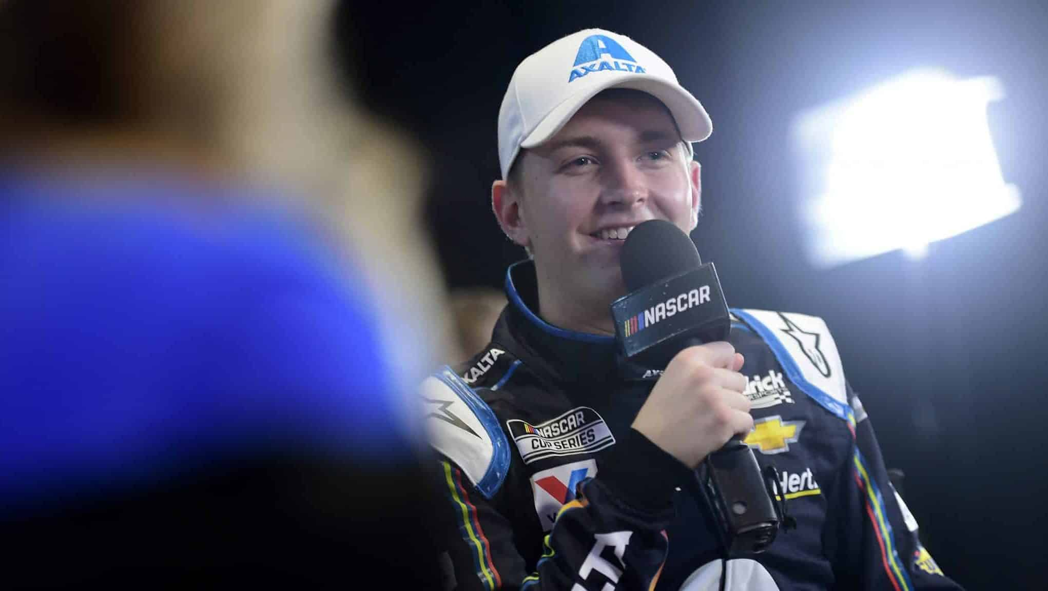 DAYTONA BEACH, FLORIDA - FEBRUARY 12: William Byron, driver of the #24 Axalta 'Color of the Year' Chevrolet, speaks with the media during the NASCAR Cup Series 62nd Annual Daytona 500 Media Day at Daytona International Speedway on February 12, 2020 in Daytona Beach, Florida.