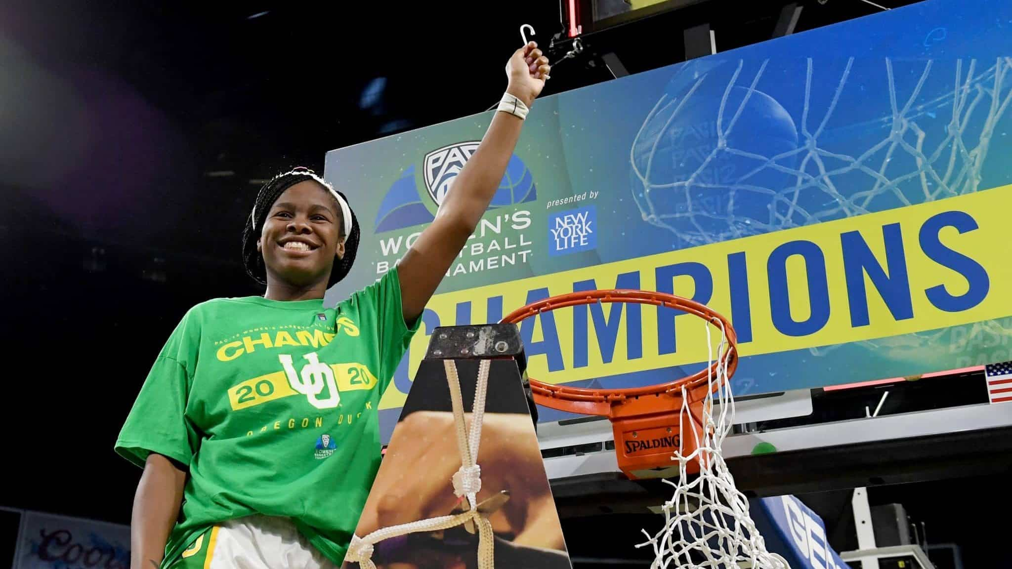 LAS VEGAS, NEVADA - MARCH 08: Ruthy Hebard #24 of the Oregon Ducks cuts down a net after the team defeated the Stanford Cardinal 89-56 to win the championship game of the Pac-12 Conference women's basketball tournament at the Mandalay Bay Events Center on March 8, 2020 in Las Vegas, Nevada. (
