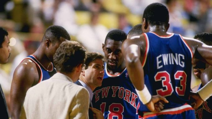 Oct 1987: Head coach Rick Pitino of the New York Knicks talks to Patrick Ewing #33 and other teammates during a Knicks versus Los Angeles Lakers game at the Great Western Forum in Inglewood, California.