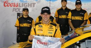 CHARLOTTE, NC - MAY 21: Matt Kenseth, driver of the #20 DeWalt Toyota, poses with the Coors Light Pole Award after qualifying for pole position for the NASCAR Sprint Cup Series Coca-Cola 600 at Charlotte Motor Speedway on May 21, 2015 in Charlotte, North Carolina.