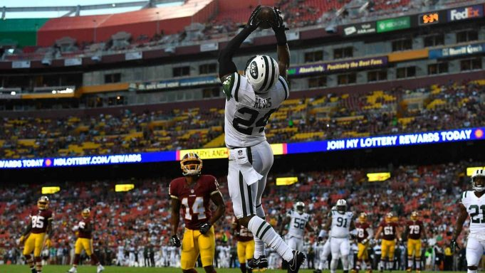 LANDOVER, MD - AUGUST 19: Cornerback Darrelle Revis #24 of the New York Jets makes a first half interception against the Washington Redskinsat at FedExField on August 19, 2016 in Landover, Maryland.