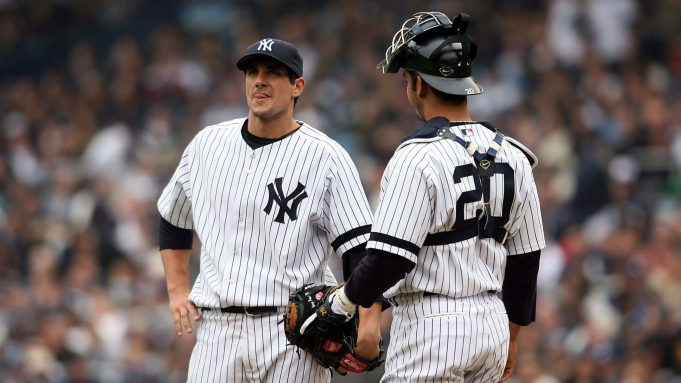 NEW YORK - APRIL 02: Starting pitcher Carl Pavano #45 of the New York Yankees talks with catcher Jorge Posada #20 on the mound after pitching against the Tampa Bay Devil Rays during their Opening Day game at Yankee Stadium April 2, 2007 in the Bronx borough of New York City. The Yankees defeated the Devil Rays, 9-5.