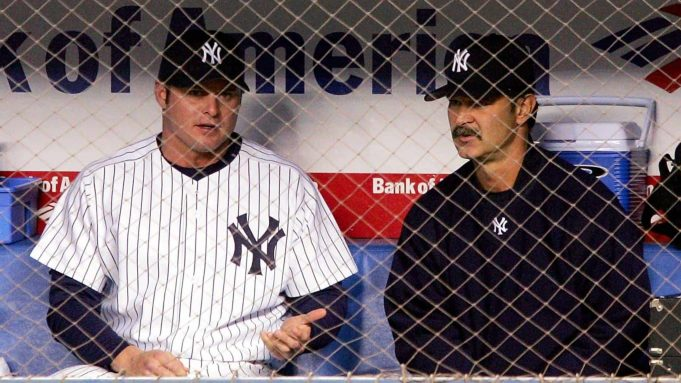 BRONX, NY - MAY 10: Jason Giambi #25 of the New York Yankees speaks with the Yankees Hitting Coach Don Mattingly in the dugout during the Yankees game against the Seattle Mariners at Yankee Stadium on May 10, 2005 in Bronx, New York.
