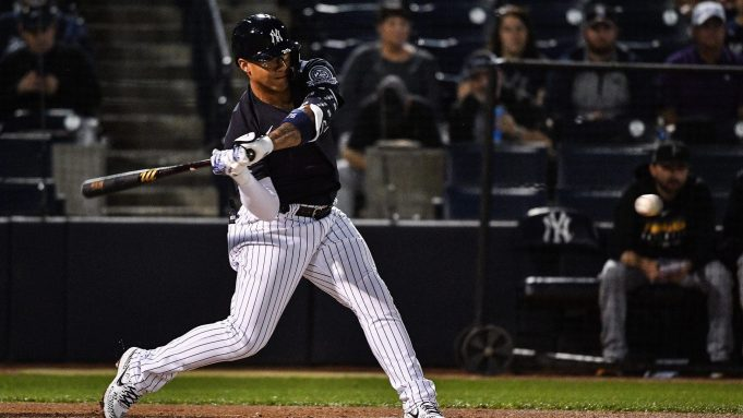 TAMPA, FLORIDA - FEBRUARY 24: Gleyber Torres #25 of the New York Yankees reaches first base on a fielding error in the first inning during the spring training game against the Pittsburgh Pirates at Steinbrenner Field on February 24, 2020 in Tampa, Florida.