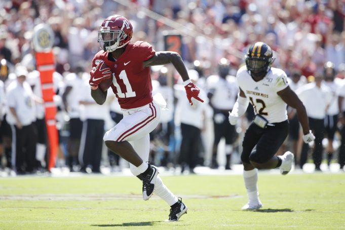 TUSCALOOSA, AL - SEPTEMBER 21: Henry Ruggs III #11 of the Alabama Crimson Tide runs for a 45-yard touchdown in the first quarter after catching a pass behind D.Q. Thomas #12 of the Southern Mississippi Golden Eagles at Bryant-Denny Stadium on September 21, 2019 in Tuscaloosa, Alabama. (