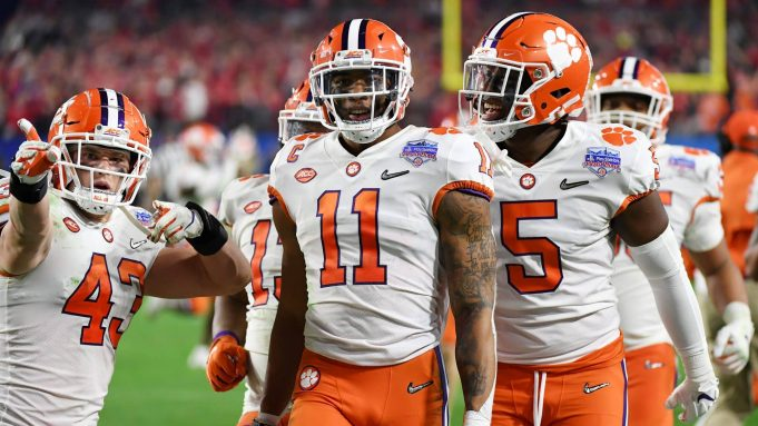 GLENDALE, ARIZONA - DECEMBER 28: Isaiah Simmons #11 of the Clemson Tigers is congratulated by his teammates after an interception against the Ohio State Buckeyes in the second half during the College Football Playoff Semifinal at the PlayStation Fiesta Bowl at State Farm Stadium on December 28, 2019 in Glendale, Arizona.