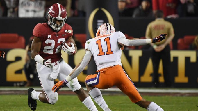 SANTA CLARA, CA - JANUARY 07: Najee Harris #22 of the Alabama Crimson Tide runs against Isaiah Simmons #11 of the Clemson Tigers in the CFP National Championship presented by AT&T at Levi's Stadium on January 7, 2019 in Santa Clara, California.