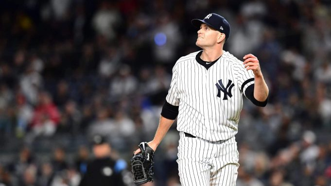NEW YORK, NEW YORK - OCTOBER 04: James Paxton #65 of the New York Yankees reacts after giving up a home run hit by Jorge Polanco #11 of the Minnesota Twins during the first inning in game one of the American League Division Series at Yankee Stadium on October 04, 2019 in New York City.