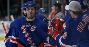 NEW YORK - MARCH 25: Jaromir Jagr #68 of the New York Rangers is congratulated by team mates after scoring a goal against the Philadelphia Flyers during their game on March 25, 2008 at Madison Square Garden in New York City.