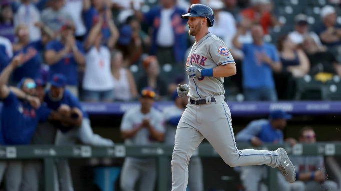 DENVER, COLORADO - SEPTEMBER 18: Jeff McNeil #6 of the New York Mets scores on a Seth Lugo single in the ninth inning against the Colorado Rockies at Coors Field on September 18, 2019 in Denver, Colorado.