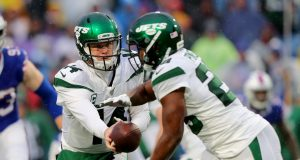 ORCHARD PARK, NY - DECEMBER 29: Sam Darnold #14 of the New York Jets hands the ball off to Bilal Powell #29 of the New York Jets during the second half against the Buffalo Bills at New Era Field on December 29, 2019 in Orchard Park, New York. Jets beat the Bills 13 to 6.