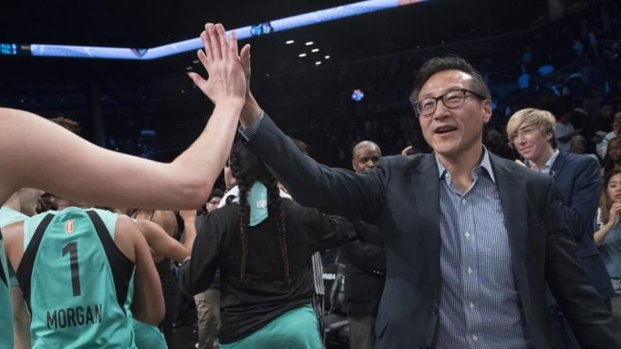 The New York Liberty's new owner, Joe Tsai, right, high-fives the Liberty players as they arrive at the bench at the end of a WNBA exhibition basketball game against China, Thursday, May 9, 2019, in New York. Tsai saw the team's exhibition game against the Chinese national team as a chance to grow relations between the two countries.