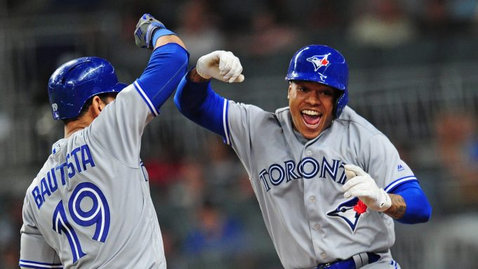 ATLANTA, GA - MAY 18: Marcus Stroman #6 of the Toronto Blue Jays is congratulated by Jose Bautista #19 after hitting a fourth inning solo home run against the Atlanta Braves at SunTrust Park on May 18, 2017 in Atlanta, Georgia.