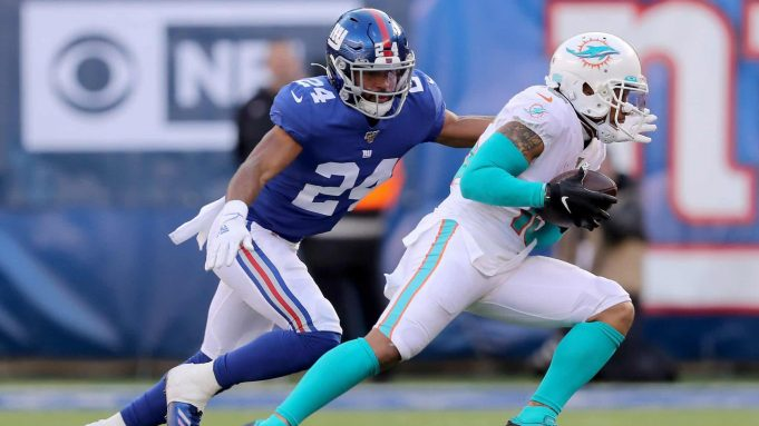 EAST RUTHERFORD, NEW JERSEY - DECEMBER 15: Albert Wilson #15 of the Miami Dolphins carries the ball as Julian Love #24 of the New York Giants defends in the second quarter at MetLife Stadium on December 15, 2019 in East Rutherford, New Jersey.