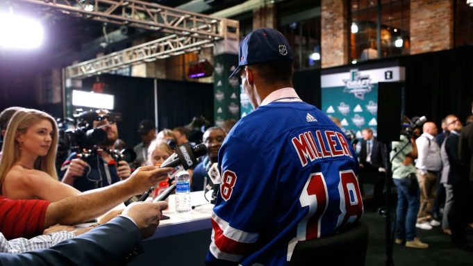 DALLAS, TX - JUNE 22: K'Andre Miller speaks to the media after being selected twenty-second overall by the New York Rangers during the first round of the 2018 NHL Draft at American Airlines Center on June 22, 2018 in Dallas, Texas.