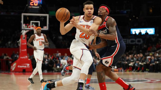 WASHINGTON, DC - MARCH 10: Kevin Knox II #20 of the New York Knicks dribbles past Bradley Beal #3 of the Washington Wizards during the first half at Capital One Arena on March 10, 2020 in Washington, DC. NOTE TO USER: User expressly acknowledges and agrees that, by downloading and or using this photograph, User is consenting to the terms and conditions of the Getty Images License Agreement.