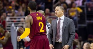 CLEVELAND, OH - DECEMBER 25: Kyrie Irving #2 of the Cleveland Cavaliers talks to head coach Tyronn Lue of the Cleveland Cavaliers during the first half against the Golden State Warriorsat Quicken Loans Arena on December 25, 2016 in Cleveland, Ohio. NOTE TO USER: User expressly acknowledges and agrees that, by downloading and/or using this photograph, user is consenting to the terms and conditions of the Getty Images License Agreement. Mandatory copyright notice.