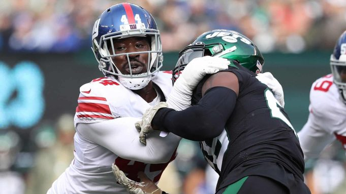 EAST RUTHERFORD, NEW JERSEY - NOVEMBER 10: Markus Golden #44 of the New York Giants pulls down Le'Veon Bell #26 of the New York Jets in the first quarter at MetLife Stadium on November 10, 2019 in East Rutherford, New Jersey.